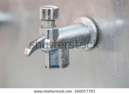 Aluminum faucet of drink water - stock photo