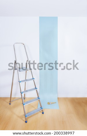 Aluminum ladder in interior room with roll paper - stock photo