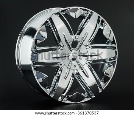 Aluminum metal wheel rim texture. Car alloy wheel, isolated on black background - stock photo