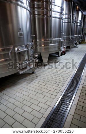 Aluminum tanks in the cellar of a French winery - stock photo