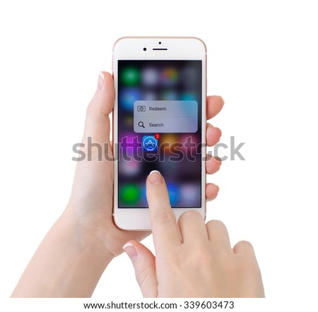 Alushta, Russia - November 13, 2015: iPhone6S Rose Gold with function 3D Touch and app Apple Music. iPhone 6S Rose Gold was created and developed by the Apple inc. - stock photo