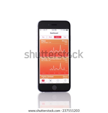 Alushta, Russia - November 11, 2014: New iPhone 6 Space Gray with Apple service Health on the screen. iPhone 6 was created and developed by the Apple inc. - stock photo
