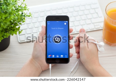 Alushta, Russia - October 25, 2014: Girl holding a iPhone 6 Space Gray with music service Shazam on the screen. iPhone 6 was created and developed by the Apple inc. - stock photo