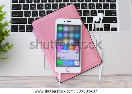 Alushta, Russia - October 27, 2015: iPhone6S Rose Gold with function 3D Touch and app Apple Music. iPhone 6S Rose Gold was created and developed by the Apple inc. - stock photo