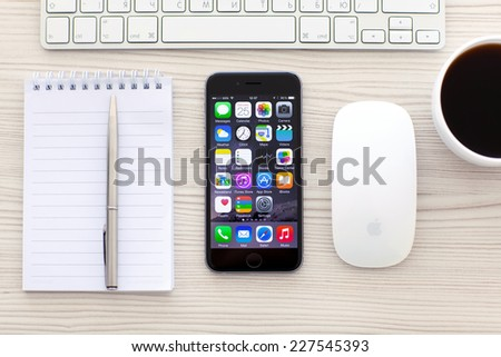 Alushta, Russia - October 25, 2014: New phone iPhone 6 Space Gray with apps on screen lies on the table. iPhone 6 was created and developed by the Apple inc. - stock photo