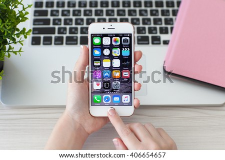 Alushta, Russia - October 27, 2015: Woman holding iPhone6S Rose Gold. iPhone 6S Rose Gold was created and developed by the Apple inc. - stock photo