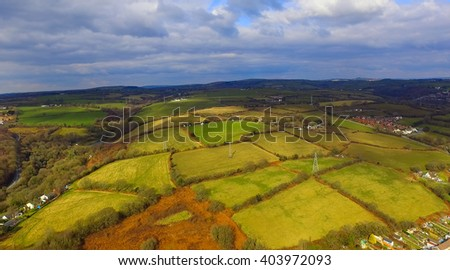 Am aerial view of sectioned fields in the countryside. - stock photo