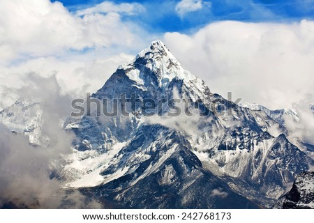 Ama Dablam mount in Sagarmatha National park, Everest region, Nepal. Ama Dablam (6858 m) is one of the most spectacular mountains in the world and a true alpinists dream. - stock photo