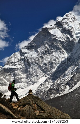Ama-Dablam North face and climber - stock photo