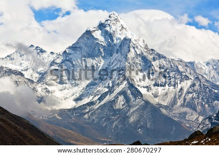 Ama Dablam peak in Sagarmatha National park, Everest region, Nepal. Ama Dablam (6858 m) is one of the most spectacular mountains in the world and a true alpinists dream. - stock photo