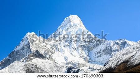 amadablam peak from everest trek route in nepal - stock photo