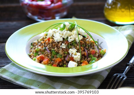 Amaranth and Buckwheat with vegetables and feta cheese - stock photo