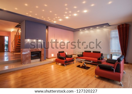 Amaranth house - Living room with a red sofa - stock photo