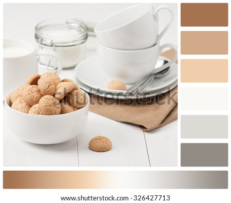 Amaretti Biscuits. Kitchenware. White Wooden Table. Palette With Complimentary Colour Swatches. - stock photo