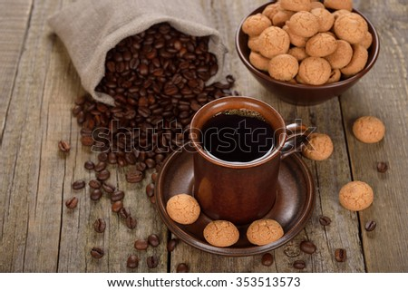Amaretti cookies with coffee on a wooden background - stock photo
