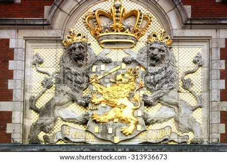 Amasing detail of the Amsterdam Central Train Station, The coat of arms of the Netherlands. - stock photo