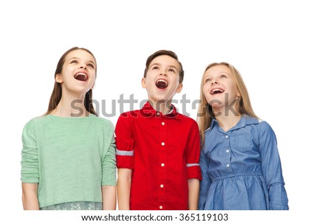 amazed boy and girls looking up - stock photo