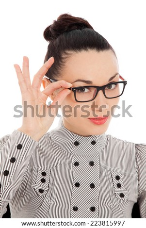 amazed brunette holding her glasses over white background - stock photo