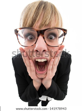 Amazed business woman screaming with hands in her face - stock photo