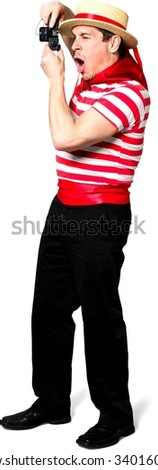 Amazed Caucasian man with short black hair in costume using camera - Isolated - stock photo