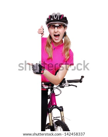 Amazed cyclist girl pointing to the vertical blank board on white background - stock photo