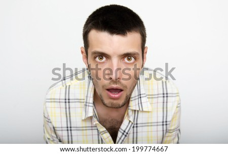 Amazed funny man - stock photo