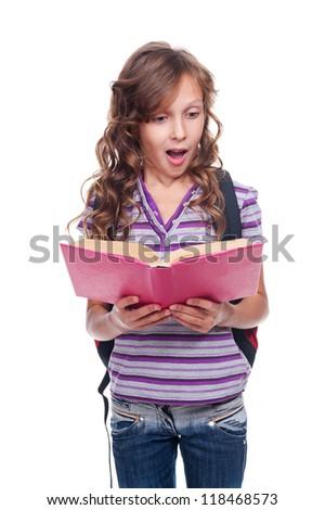 amazed little girl reading the textbook. isolated on white background - stock photo