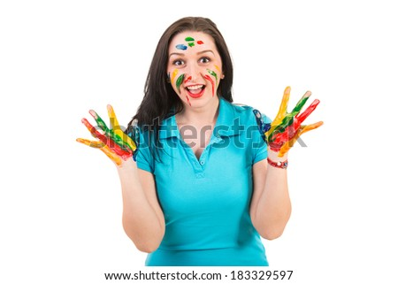 Amazed wman with hands in colorful paints isolated on white background - stock photo