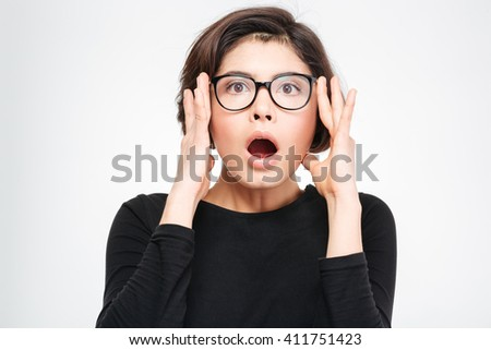 Amazed woman looking at camera isolated on a white background - stock photo