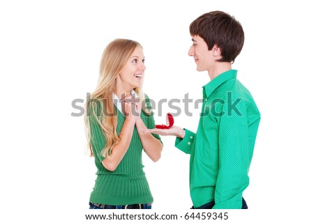 amazed woman looking at present and happy man looking at her - stock photo