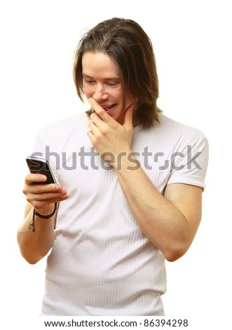 Amazed young man reading sms on his cellphone isolated on white - stock photo