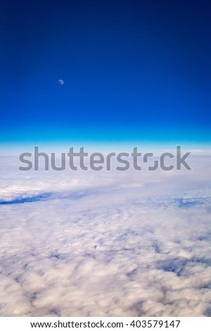 Amazing Aerial View of Clouds and Moon - Panoramic Birds Eye View of White Clouds and Blue Sky, Vertical - stock photo