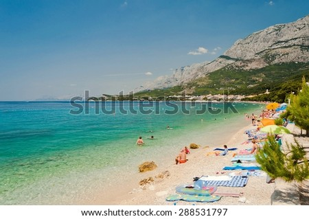 Amazing beach with people in Tucepi, Croatia. Tucepi is a popular holiday resort in Croatia - stock photo