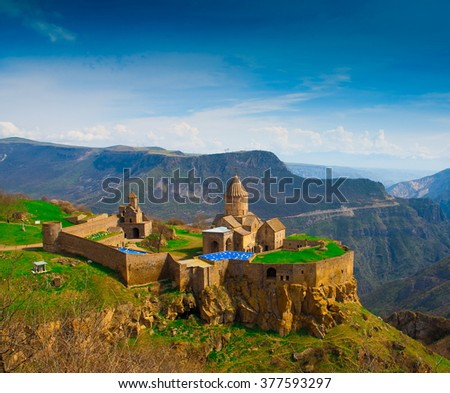 Amazing beautiful mountain landscape. Old christianity unique church monastery Tatev. Blue sky. Sunny day. Armenia country. UNESCO World Heritage. - stock photo