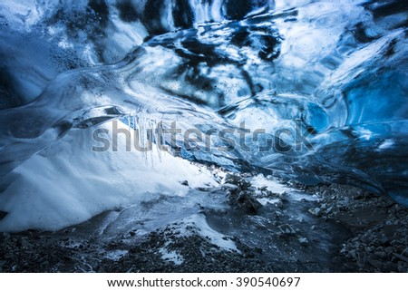 Amazing Blue Ice Cave in the heart of a glacier near Jokulsarlon, Vatnajokull National Park, Iceland - stock photo