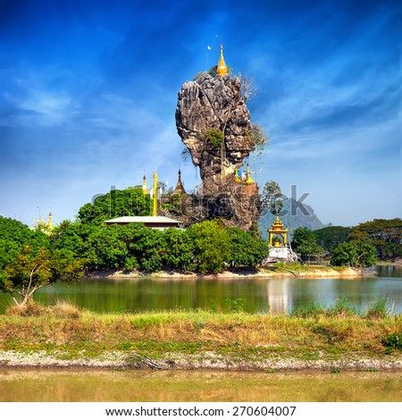 Amazing Buddhist Kyauk Kalap Pagoda under blue sky. Hpa-An, Myanmar (Burma) travel landscapes and destinations - stock photo