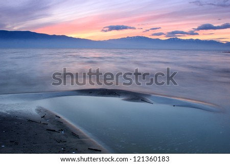 Amazing dusk sky by the shore of a lake in Utah, USA. - stock photo