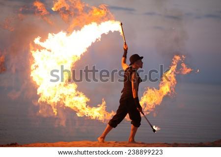 Amazing fire performance, solo - stock photo
