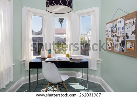 Amazing fresh looking home office in light turquoise, with modern desk, view window and decorated pinwall, pin wall. - stock photo