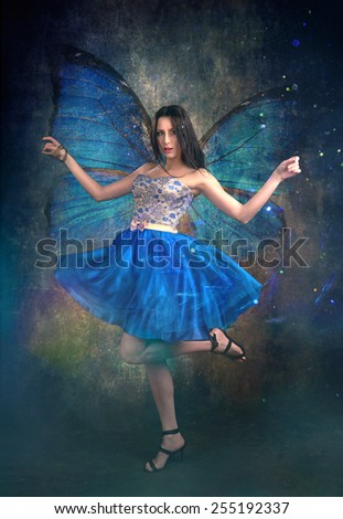 Amazing Girl With Blue Butterfly Wings  - stock photo