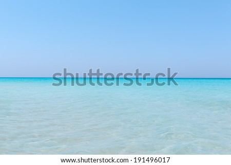 amazing, gorgeous natural background of turquoise, tranquil ocean merging with clear beautiful sky at horizon line on sunny warm day - stock photo