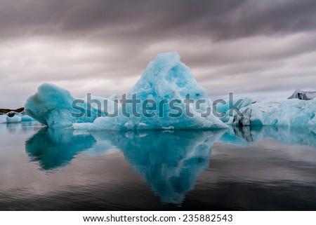 Amazing Jokulsarlon glacial lake full of floating  and melting icebergs in Iceland. - stock photo