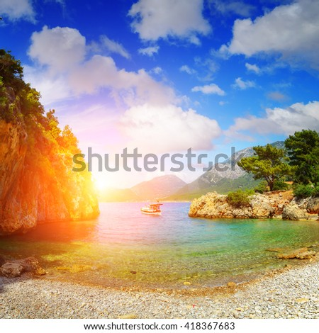 amazing lagoon with alone boat - stock photo