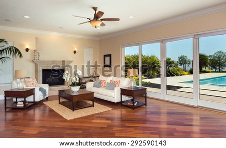 Amazing Living room with fire place and large scenic folding doors leading to outdoor pool. Modern villa, interior, beautiful living room - stock photo