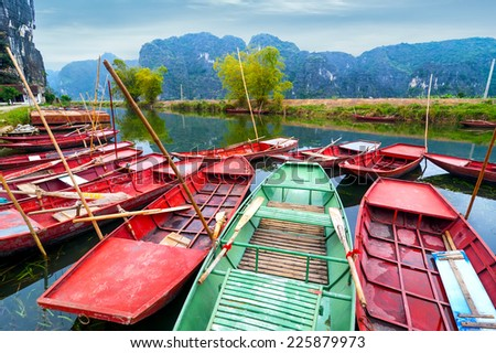 Amazing morning view with Vietnamese boats at river. Tam Coc, Ninh Binh,. Vietnam travel landscape and destinations  - stock photo