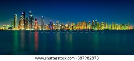 Amazing night skyline panorama reflection of Dubai Marina skyscrapers. Dubai Marina. United Arab Emirates. - stock photo