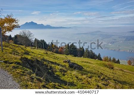 Amazing Panorama of Mount Pilatus and Lake Lucerne covered with frog, Alps, Switzerland - stock photo