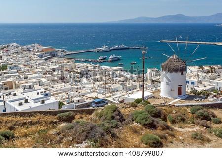 Amazing Panorama of white windmill and island of Mykonos, Cyclades, Greece - stock photo