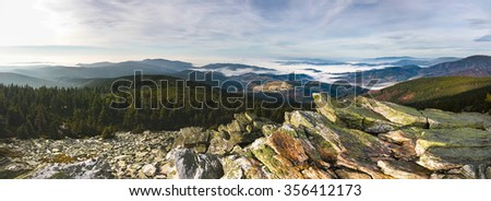 Amazing panoramic view from the sunny autumn rocky mountains into the valleys with low clouds - Jeseniky hills, Czech Republic, Europe - stock photo