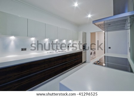 amazing penthouse kitchen with white stone worktop - stock photo